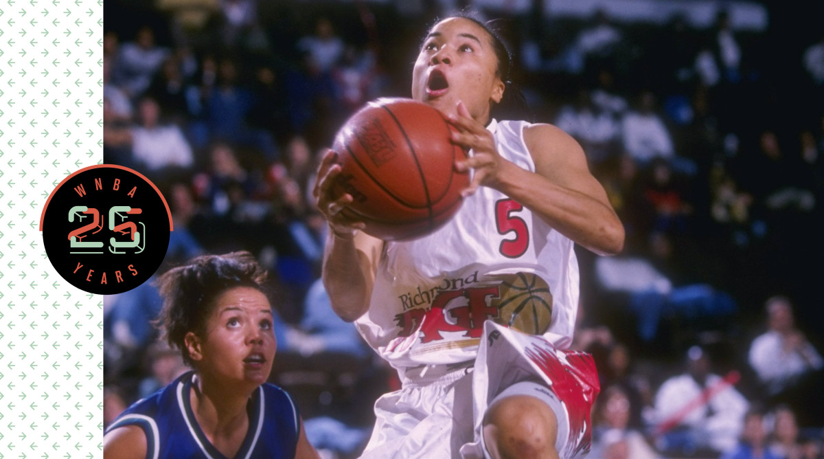 Dawn Staley holding a basketball