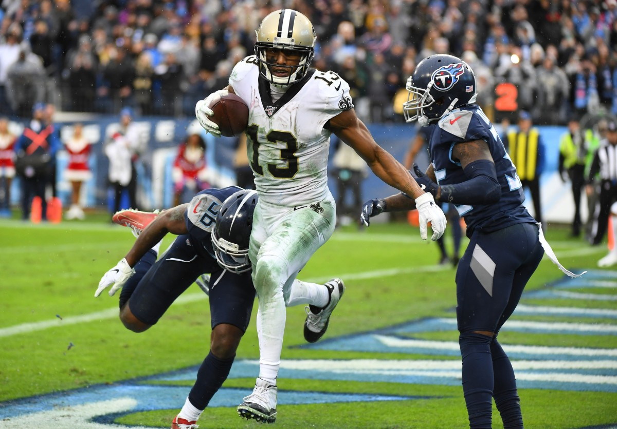 New Orleans Saints wide receiver Michael Thomas (13) breaks the record for receptions in a season with this touchdown against the Titans. Mandatory Credit: Christopher Hanewinckel-USA TODAY