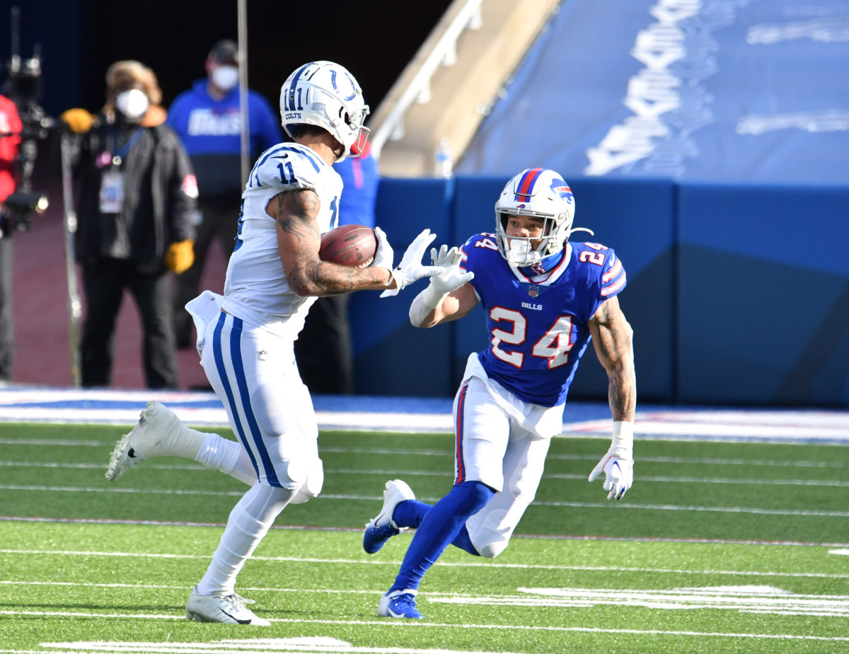 Jan 9, 2021; Orchard Park, New York, USA; Indianapolis Colts wide receiver Michael Pittman (11) tries to avoid Buffalo Bills cornerback Taron Johnson (24) after a catch in the second quarter at Bills Stadium.