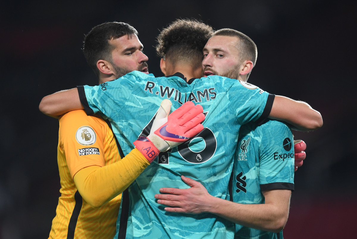 Rhys Williams, Alisson Becker and Nathaniel Phillips celebrate for Liverpool.