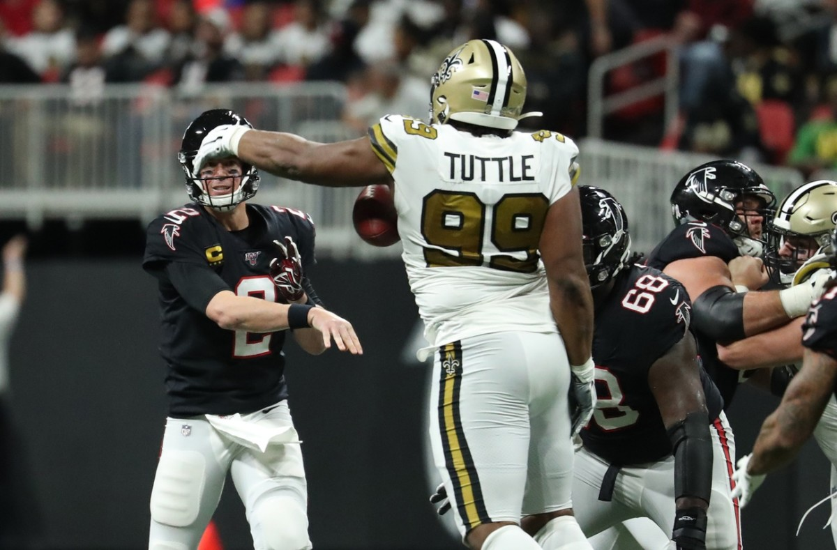 Falcons quarterback Matt Ryan (2) throws an interception to New Orleans Saints defensive tackle Shy Tuttle (99). Mandatory Credit: Jason Getz-USA TODAY Sports