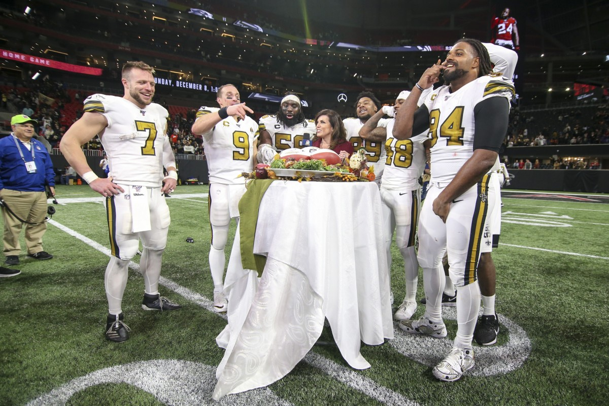 New Orleans Saints quarterbacks Taysom Hill (7) and Drew Brees (9) linebacker Demario Davis (56) defensive tackle Shy Tuttle (99) defensive back J.T. Gray (48) and defensive end Cameron Jordan (94) after a game against Atlanta at Mercedes-Benz Stadium. Mandatory Credit: Brett Davis-USA TODAY