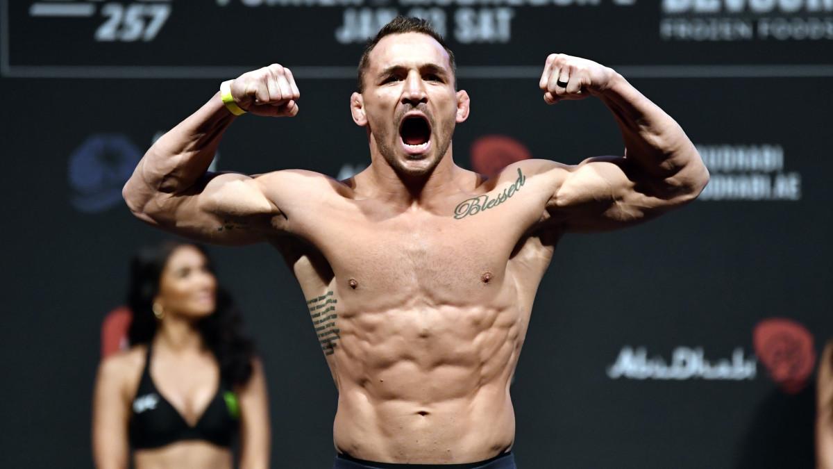 UFC's Michael Chandler flexes at a weight-in