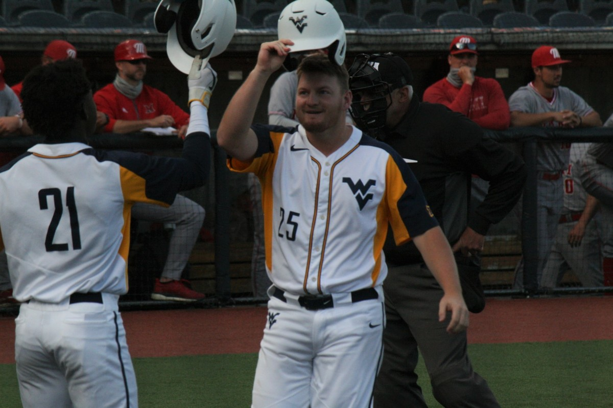 Matt McCormick celebrating with teammate Austin Davis after smacking a two-run home run in the bottom of the first inning.
