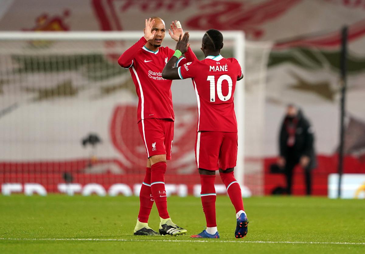 Sadio Mane & Fabinho embracing each other before kick-off