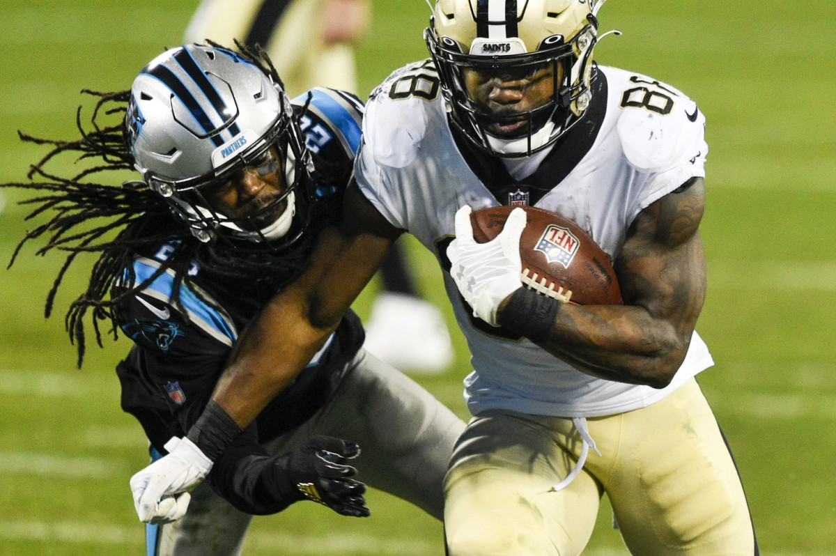 New Orleans Saints running back Ty Montgomery (88) with the ball as Carolina cornerback Donte Jackson (26) defends. Mandatory Credit: Bob Donnan-USA TODAY