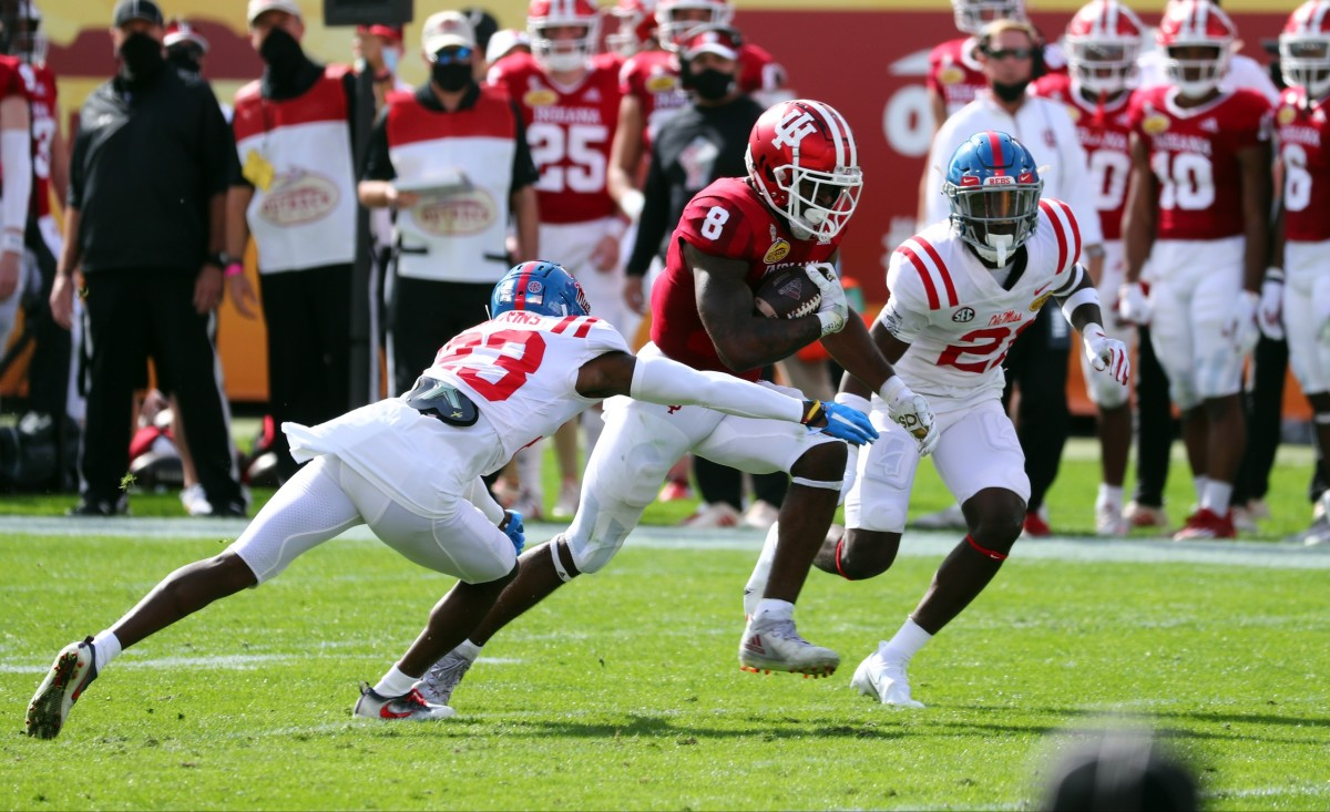 Indiana Hoosiers running back Stevie Scott III (8) runs with the ball as Mississippi defensive backs Jakorey Hawkins (23) and A.J. Finley (21). Mandatory Credit: Kim Klement-USA TODAY Sports