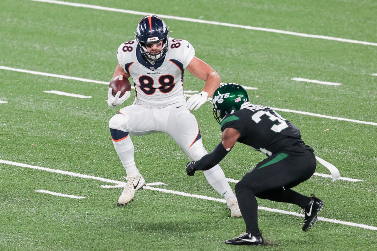 Denver Broncos tight end Nick Vannett (88) gains yards after catch as Jets cornerback Brian Poole (34) defends. Mandatory Credit: Vincent Carchietta-USA TODAY