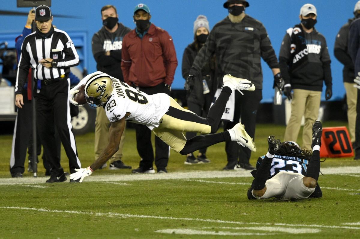 New Orleans Saints receiver Juwan Johnson (83) is tackled by Carolina cornerback Stantley Thomas-Oliver (23). Mandatory Credit: Bob Donnan-USA TODAY Sports