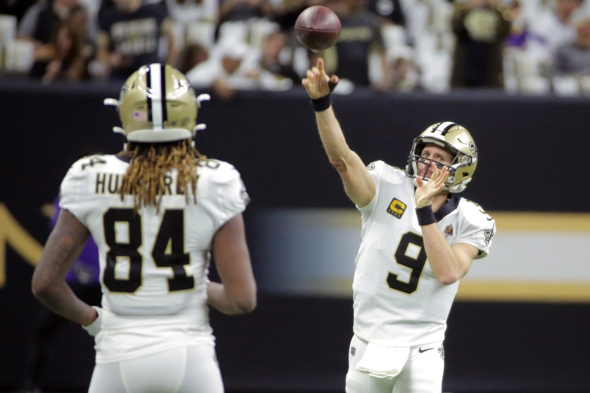 Saints quarterback Drew Brees (9) throws a warm up pass to receiver Lil'Jordan Humphrey (84) before a game against the Vikings. Mandatory Credit: Derick Hingle-USA TODAY Sports