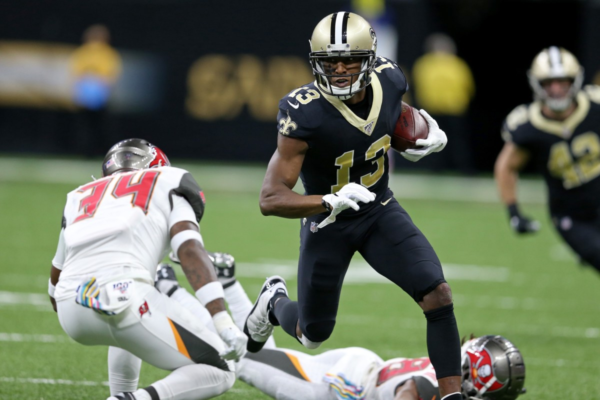 New Orleans Saints receiver Michael Thomas (13) runs the ball against Tampa Bay safety Mike Edwards (34). Mandatory Credit: Chuck Cook-USA TODAY Sports