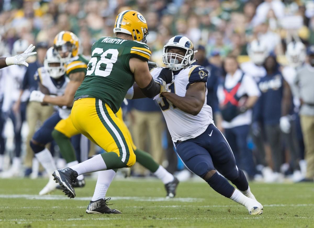 Rams linebacker Ejuan Price (51) is blocked by Green Bay Packers Kyle Murphy (68). Mandatory Credit: Jeff Hanisch-USA TODAY Sports