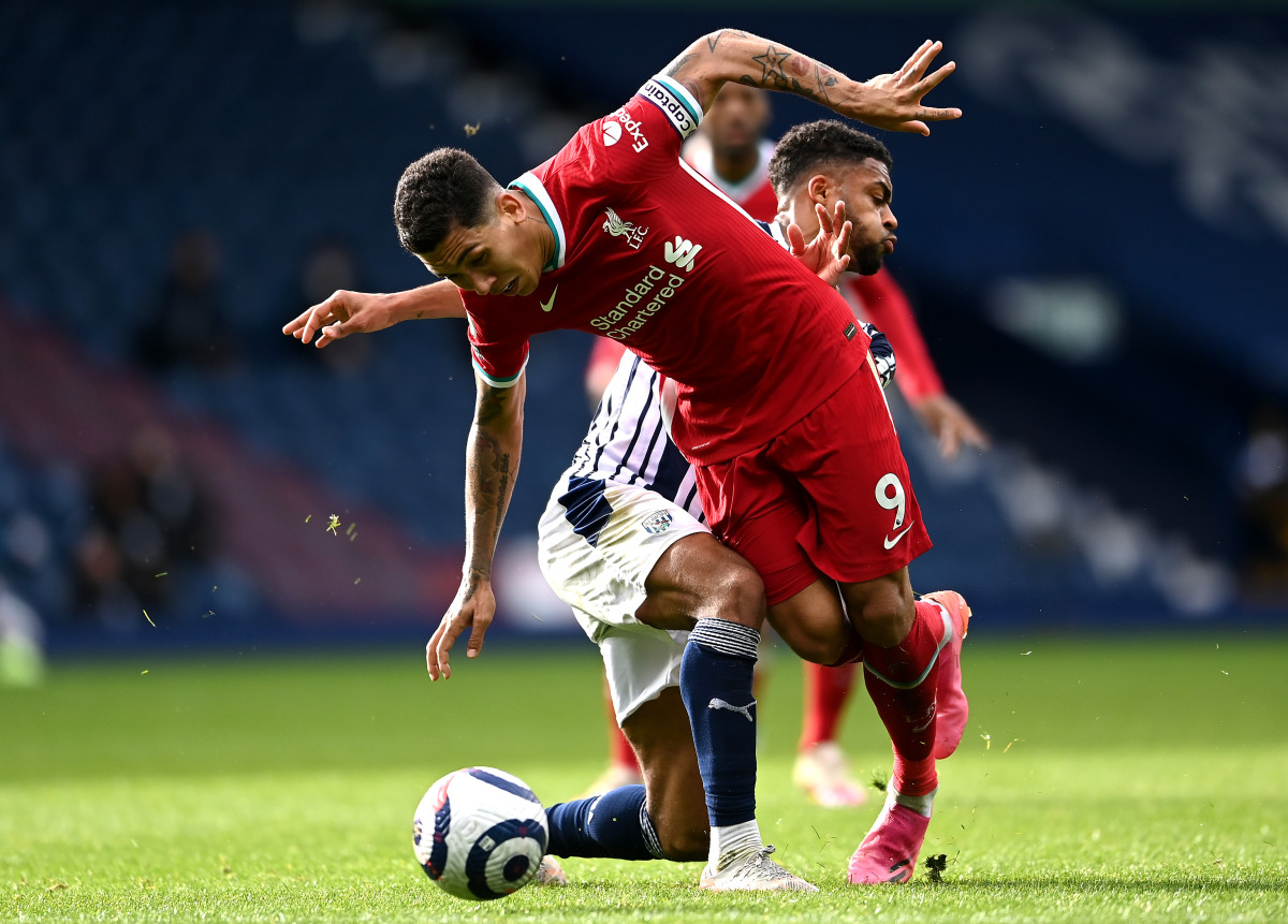 Roberto Firmino battles for the ball during Liverpool's match against West Brom.