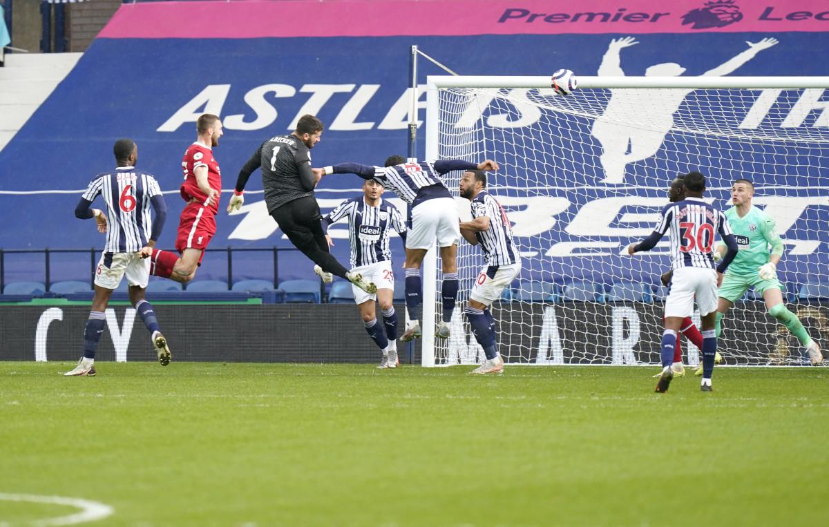 Alisson Becker scoring the winning goal for Liverpool