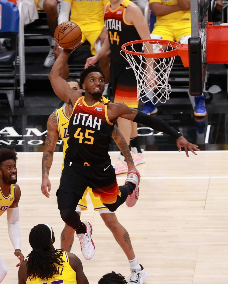 Donovan Mitchell (45) with a ferocious dunk against the Los Angeles Lakers