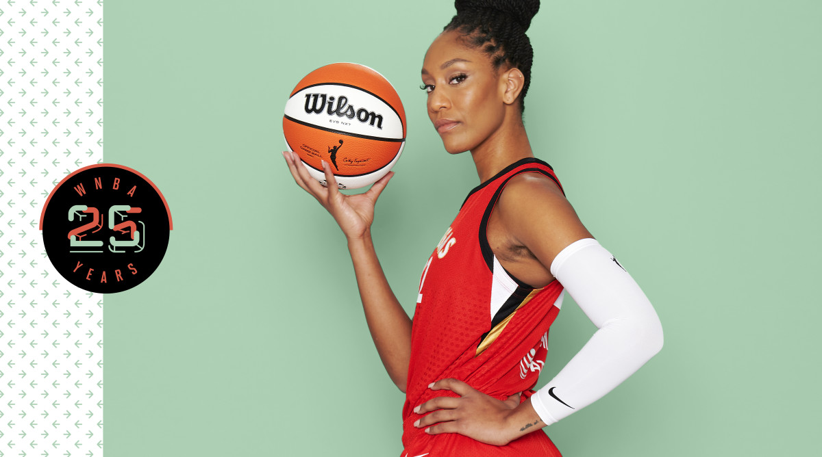 A'ja Wilson wearing a red uniform and holding a basketball in her right hand
