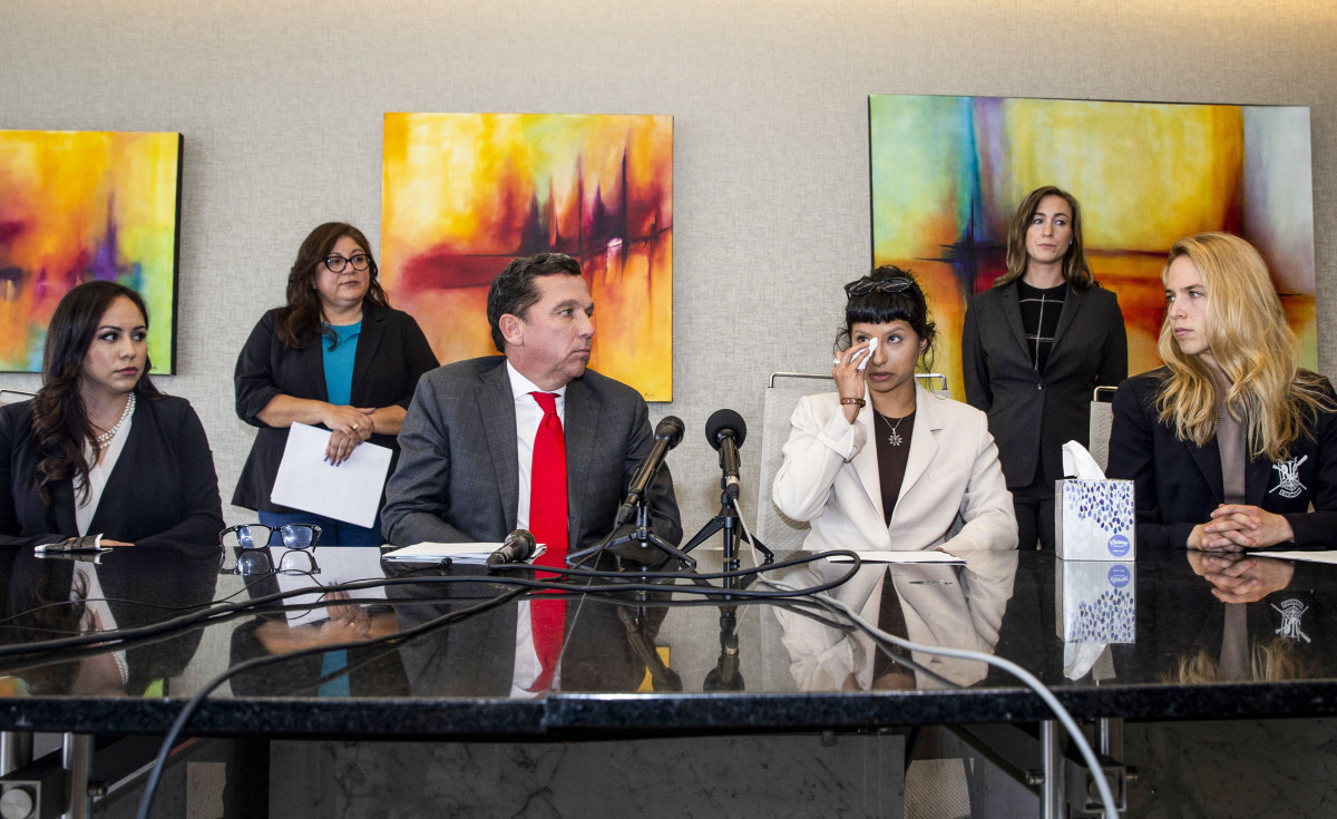 Ashley Solis, the first Jane Doe plaintiff in the Deshaun Watson lawsuits, at a press conference with lawyer Tony Buzbee