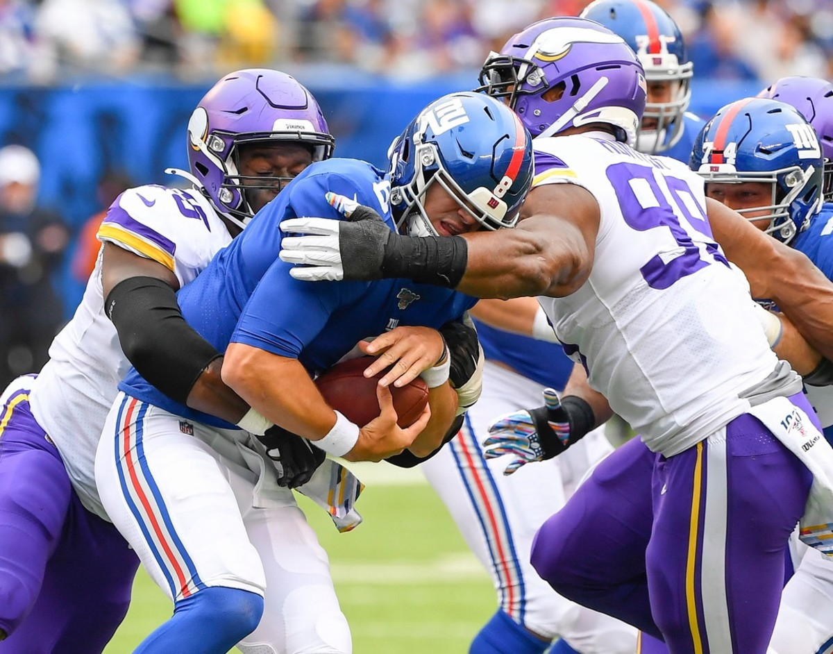 Oct 6, 2019; East Rutherford, NJ, USA; New York Giants quarterback Daniel Jones (8) is sacked by Minnesota Vikings defensive ends Ifeadi Odenigbo (95) and Danielle Hunter (99) in the 1st half at MetLife Stadium.