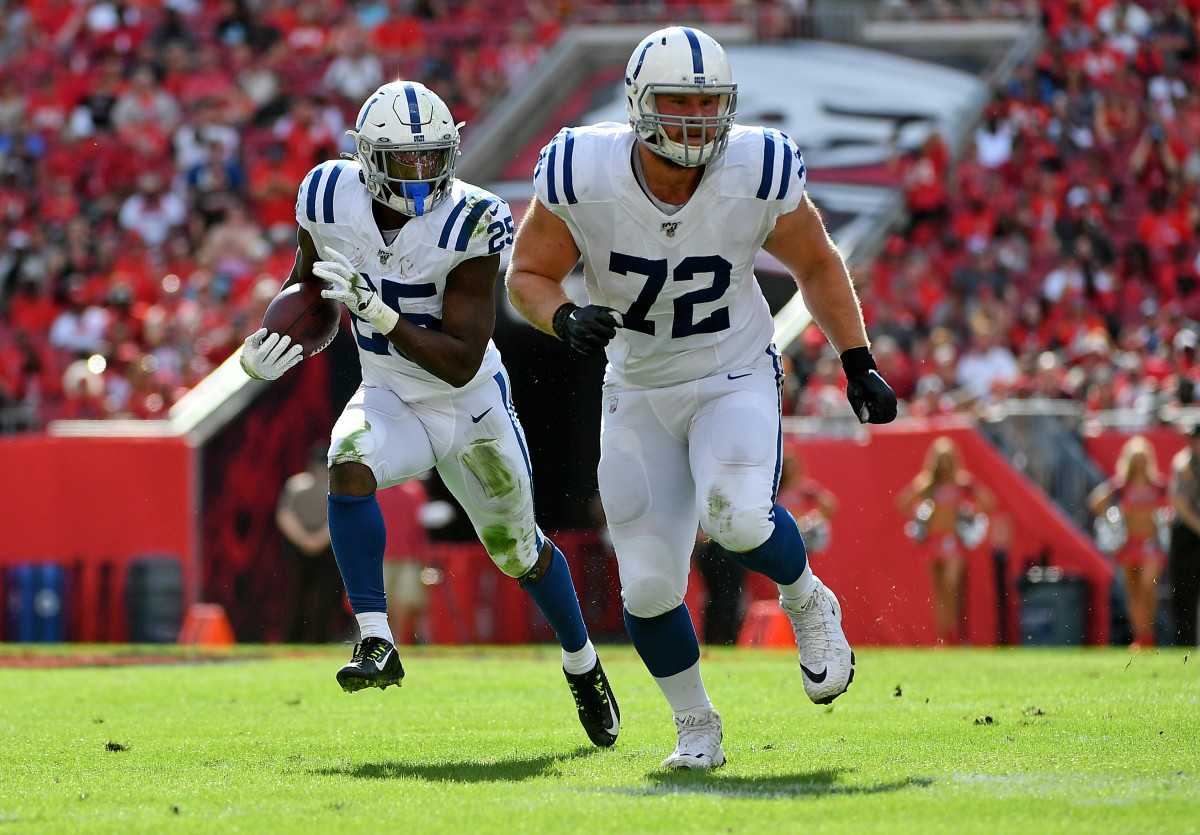 Dec 8, 2019; Tampa, FL, USA; Indianapolis Colts offensive tackle Braden Smith (72) blocks for Indianapolis Colts running back Marlon Mack (25) during the first half against the Tampa Bay Buccaneers at Raymond James Stadium. Mandatory Credit: Jasen Vinlove-USA TODAY Sports