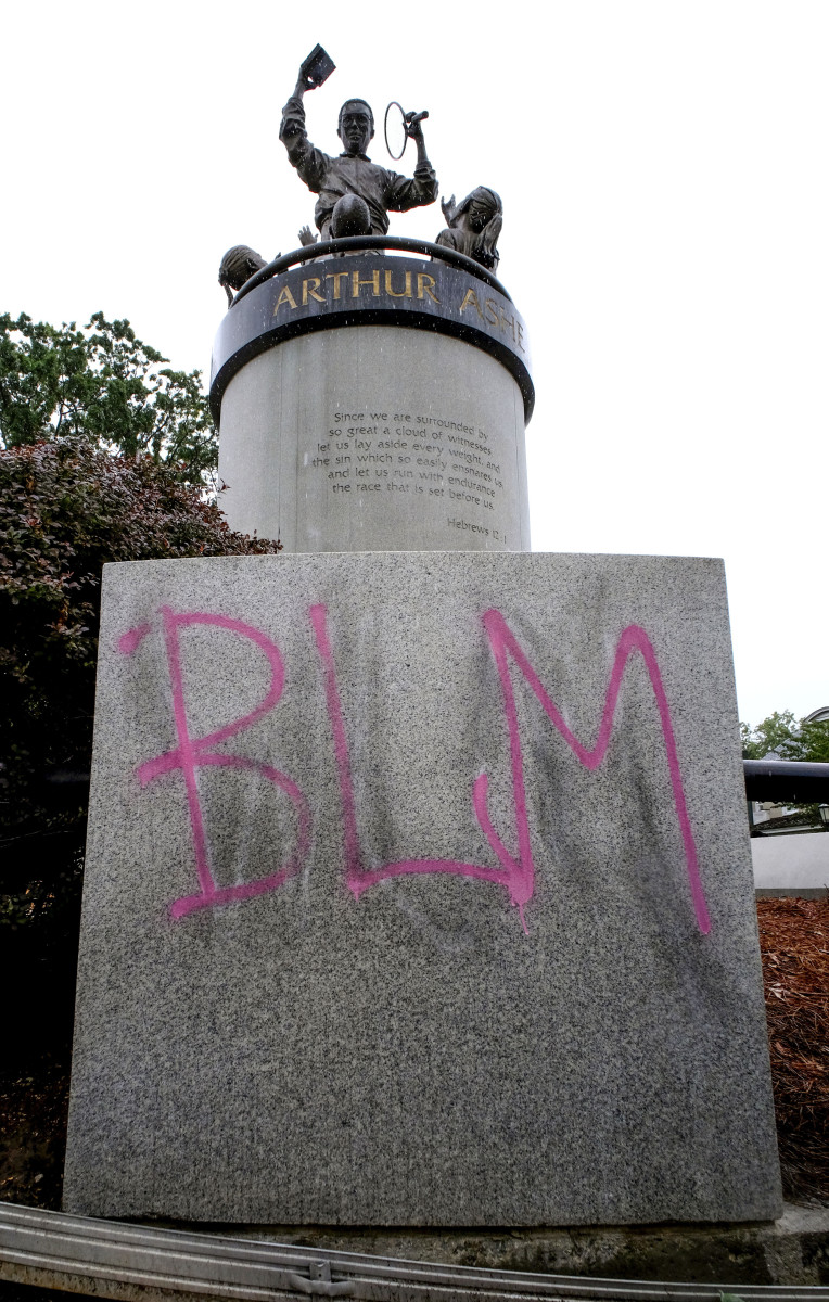 Volunteers and protesters kept Ashe's statue from being defaced with white supremacist graffiti last summer.