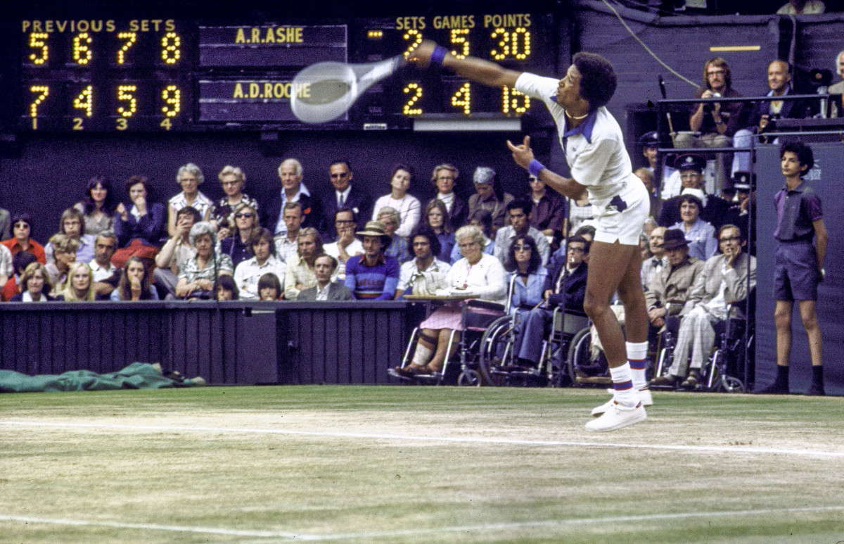 Ashe serves during the final set of his semifinal match of the 1975 Championships.