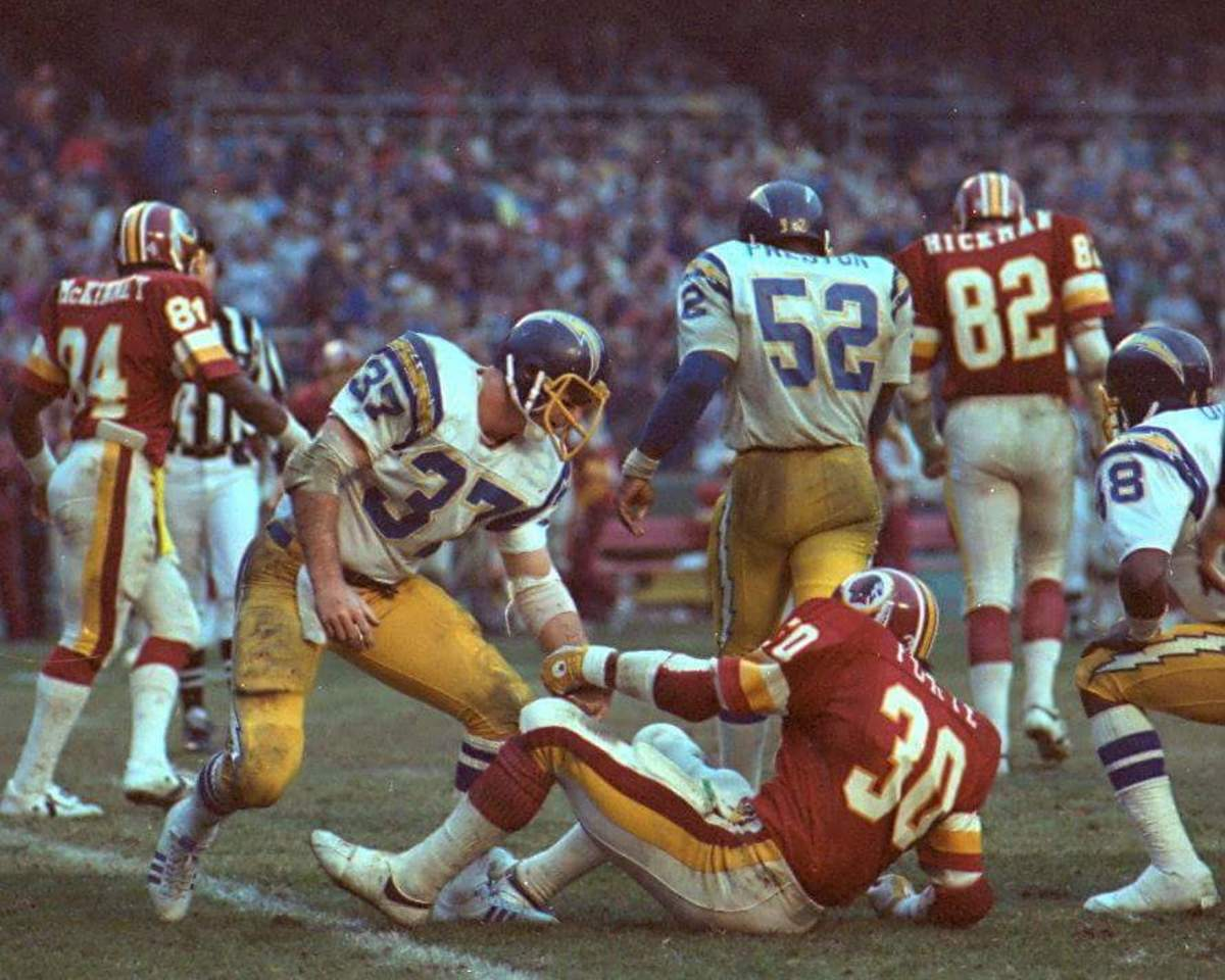 Hank Bauer (37) spent more time knocking down opponents than picking them up.