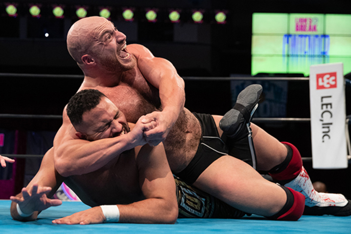 NJPW's Chris Dickinson with his opponent in a headlock