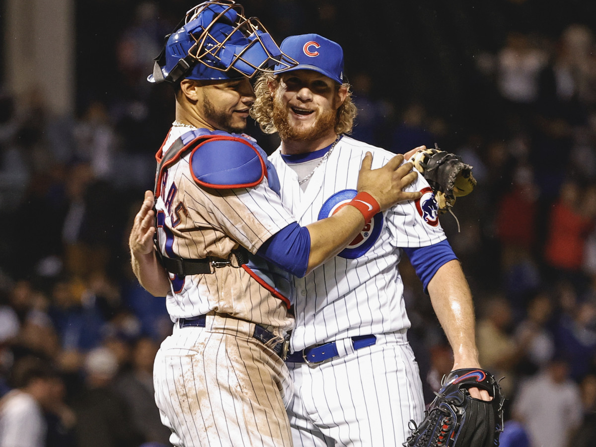 Chicago Cubs relief pitcher Craig Kimbrel (46) celebrates with catcher Willson Contreras (40) after delivering a final out against the Washington Nationals during the ninth inning at Wrigley Field.