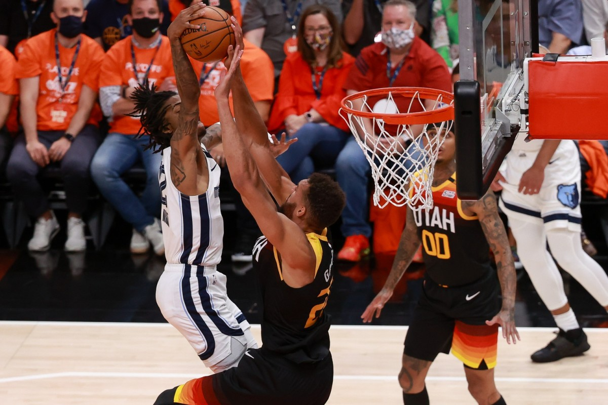 Rudy Gobert (27) rejects a dunk attempt by Ja Morant (12)