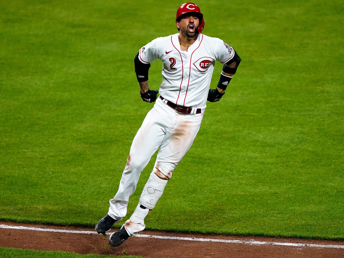 Cincinnati Reds right fielder Nick Castellanos (2) reacts after hitting a solo home run to give the 3-2 lead in the seventh inning during a baseball game against the Pittsburgh Pirates, Monday, April 5, 2021, at Great American Ball Park in Cincinnati. The Cincinnati Reds won, 5-3.
