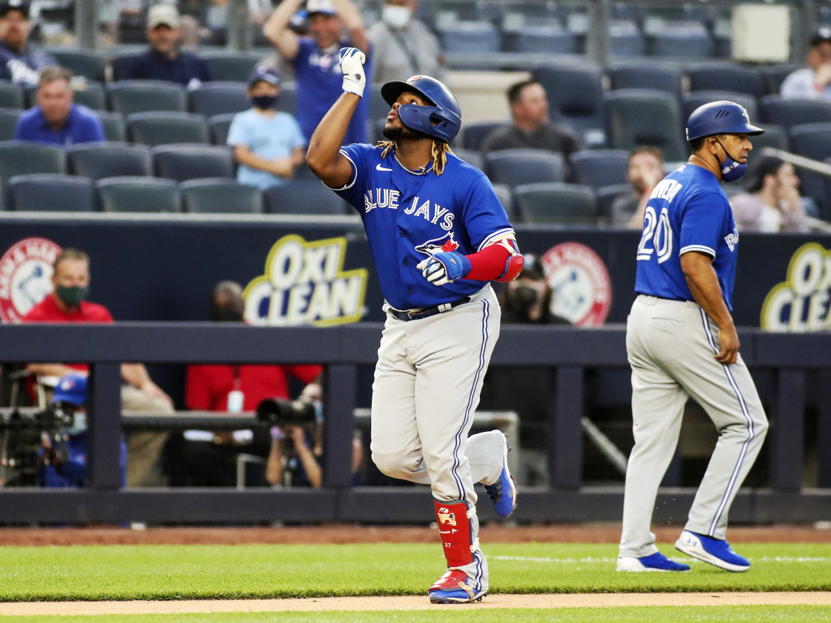 May 25, 2021; Bronx, New York, USA; Toronto Blue Jays first baseman Vladimir Guerrero Jr. (27) points to the sky after hitting a two run home in the third inning against the New York Yankees at Yankee Stadium.