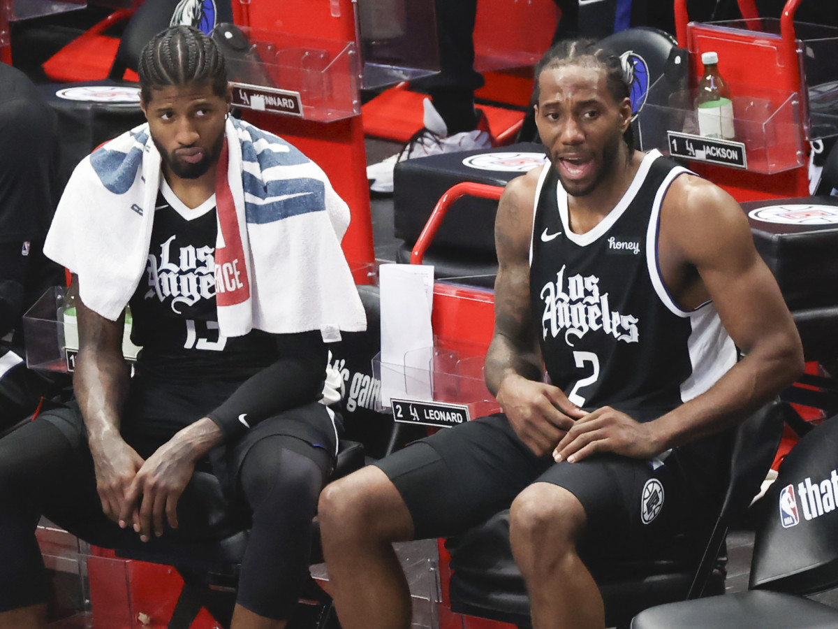 LA Clippers forward Kawhi Leonard (2) and LA Clippers guard Paul George (13) react during the fourth quarter against the Dallas Mavericks in game four in the first round of the 2021 NBA Playoffs