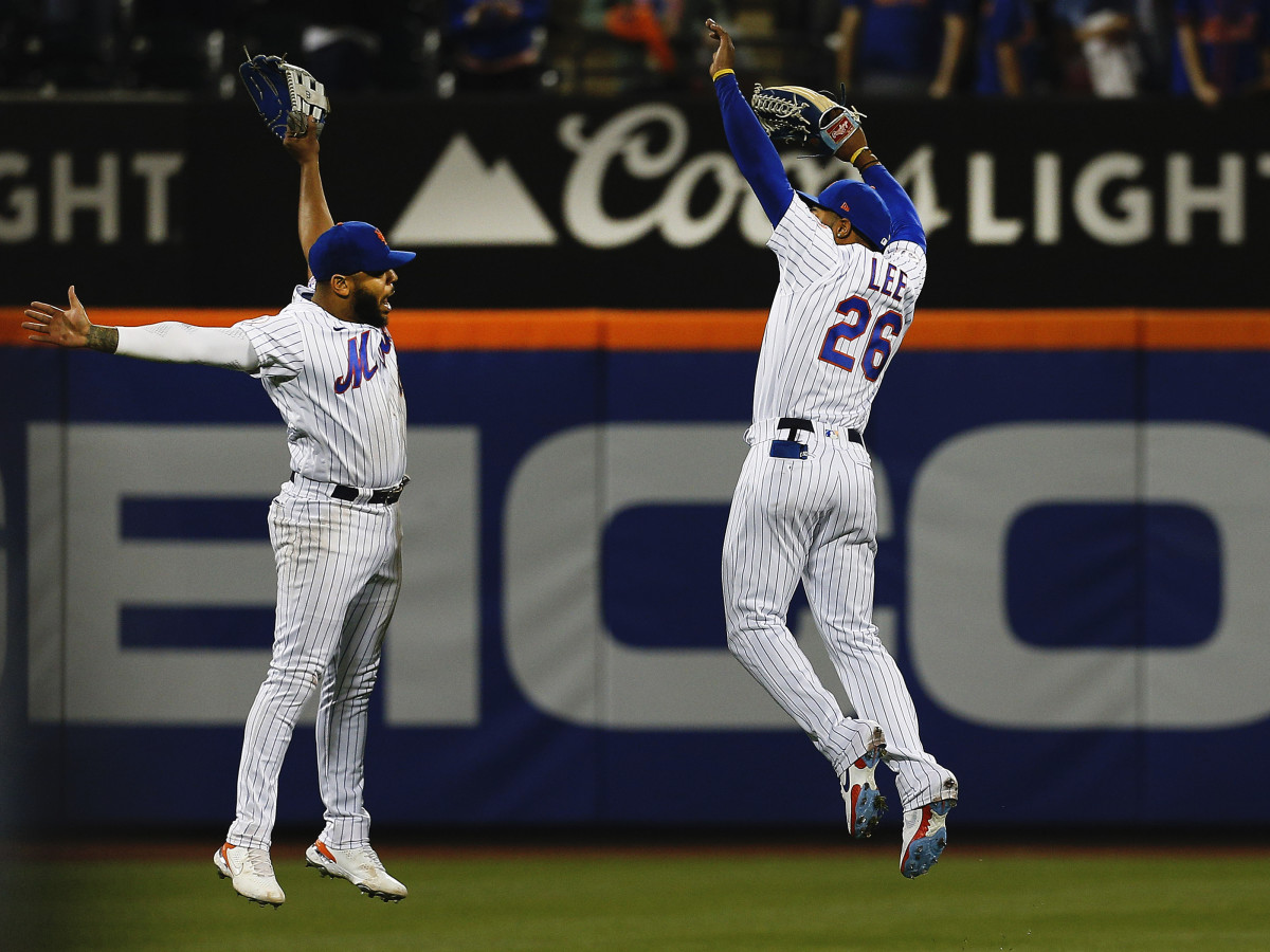 New York Mets left fielder Dominic Smith (left) and right fielder Khalil Lee (26) leap in celebration after defeating the Colorado Rockies at Citi Field.