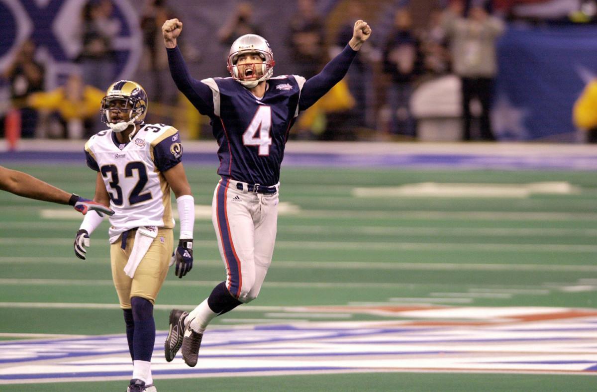 Adam Vinatieri celebrates the game-winning field goal of Super Bowl XXXVI