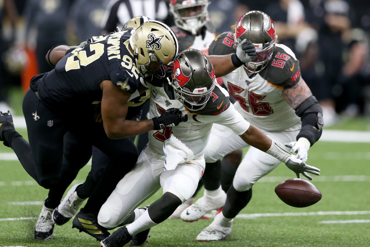 Tampa Bay quarterback Jameis Winston (3) fumbles after being hit by New Orleans defensive end Marcus Davenport (92). Mandatory Credit: Chuck Cook-USA TODAY Sports