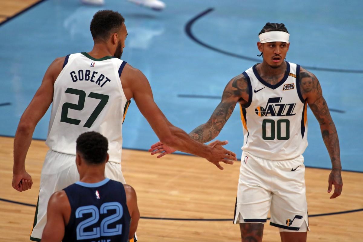 Rudy Gobert (27) and Jordan Clarkson (00) celebrate against the Memphis Grizzlies