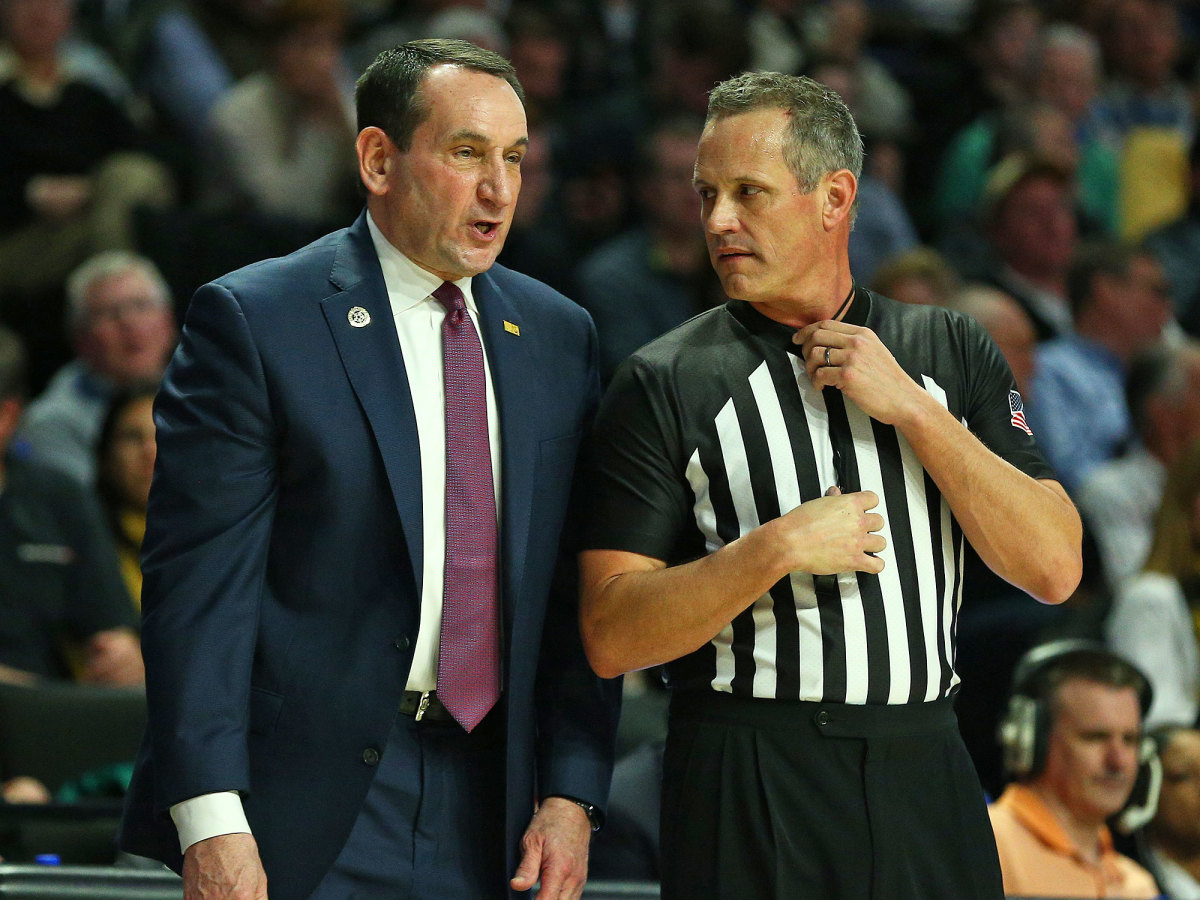 Coach K and a referee