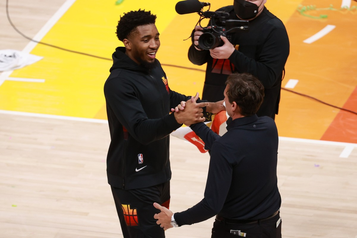 Donovan Mitchell (left) and head coach Quin Snyder (right) celebrate after the Jazz opening series win