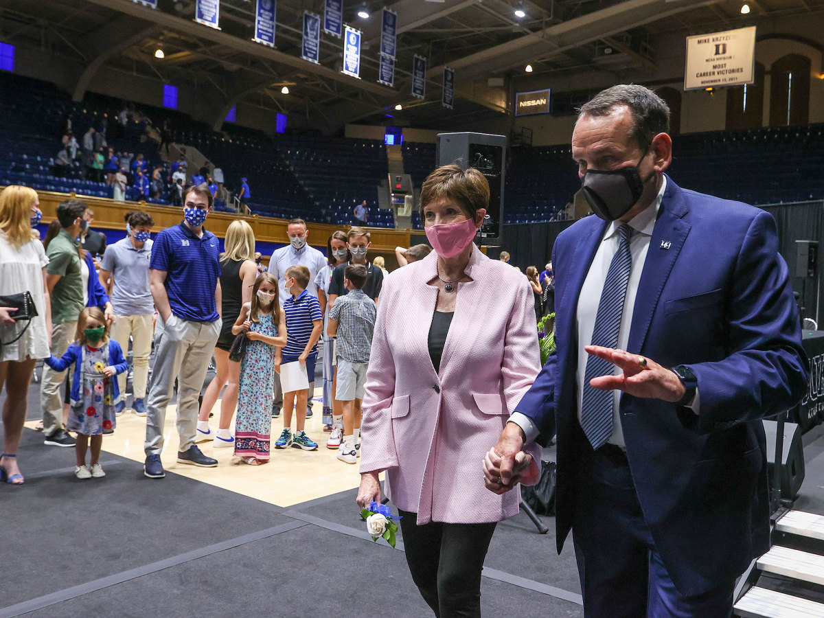 Coach K and his wife, Mickie, leave Thursday's press conference