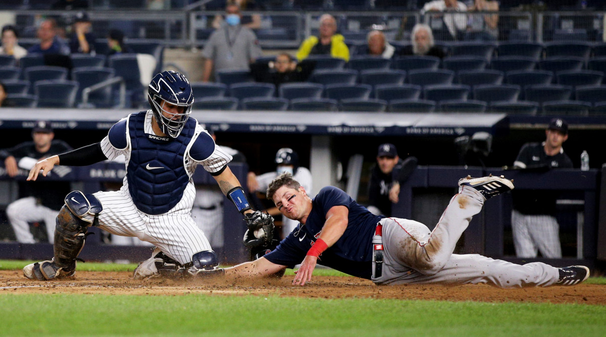 June 4, 2021; Bronx, New York, USA; Boston Red Sox right fielder Hunter Renfroe (10) slides safely into home ahead of the tag by New York Yankees catcher Gary Sánchez (24) on a double by Red Sox first baseman Marwin Gonzalez (not pictured) during the sixth inning at Yankee Stadium.