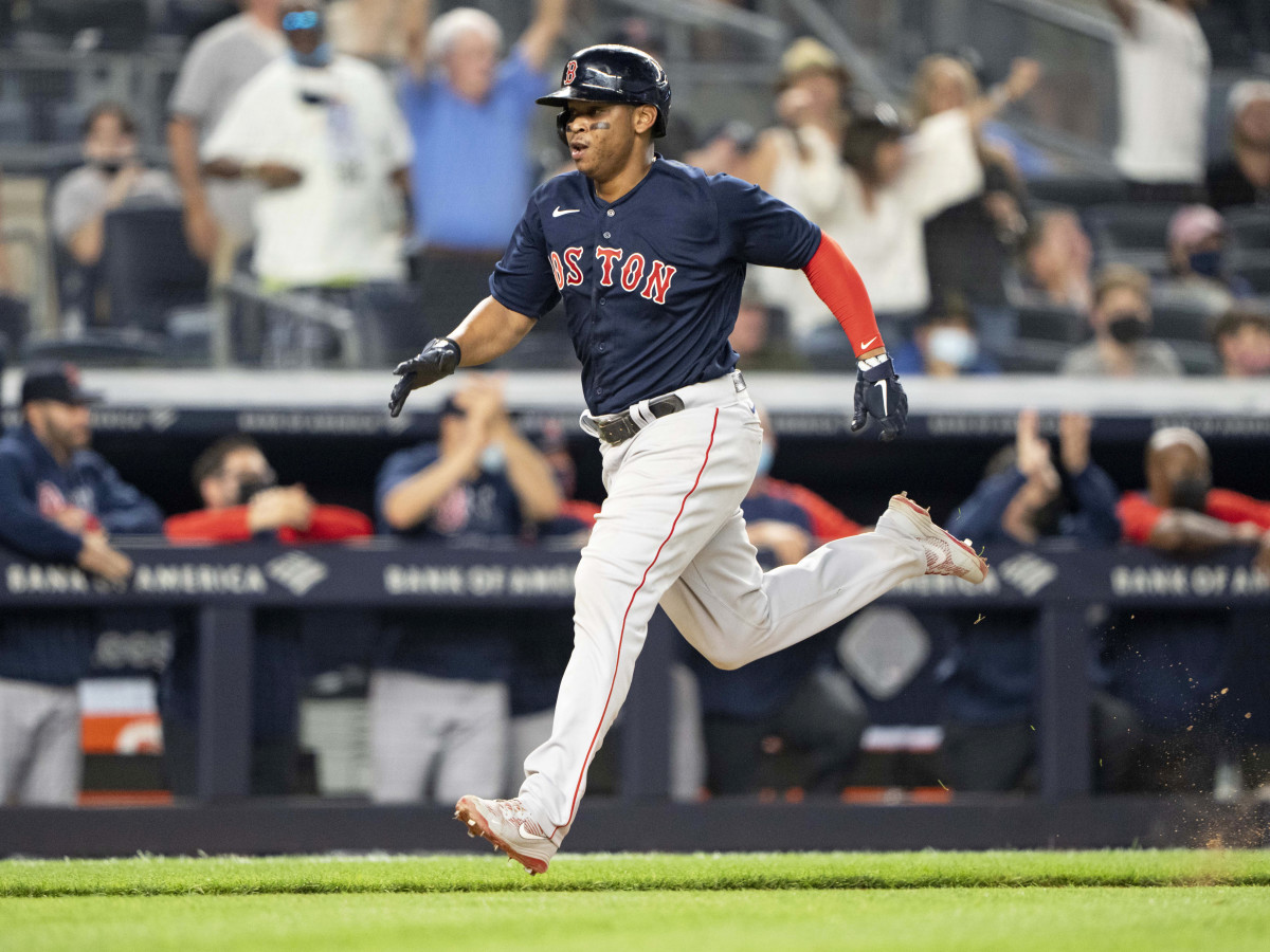 Jun 5, 2021; Bronx, New York, USA;  Boston Red Sox third baseman Rafael Devers (11) scores a run on Boston Red Sox center fielder Enrique Hernandez (5) (not pictured) RBI double during the eighth inning against the New York Yankees at Yankee Stadium.