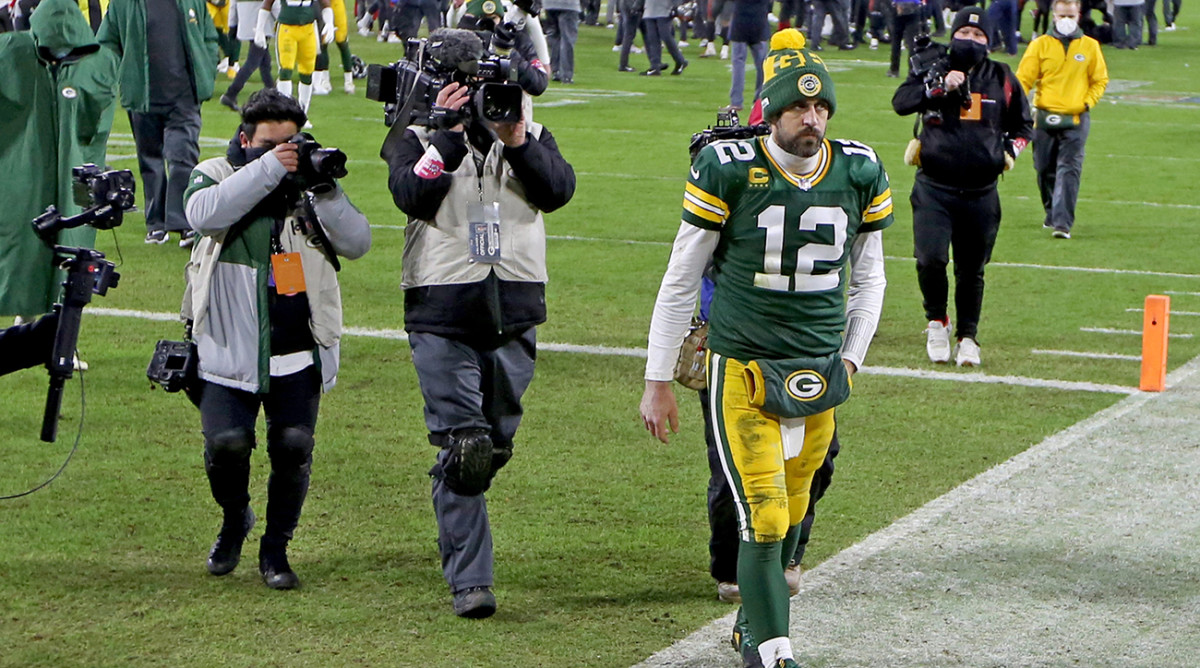 Aaron Rodgers leaves the walks off the field after the 2020 NFC Championship game.