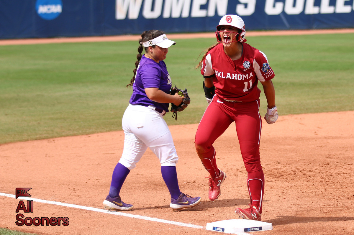 Nicole Mendes celebrates after her triple ignited the Oklahoma offense against James Madison