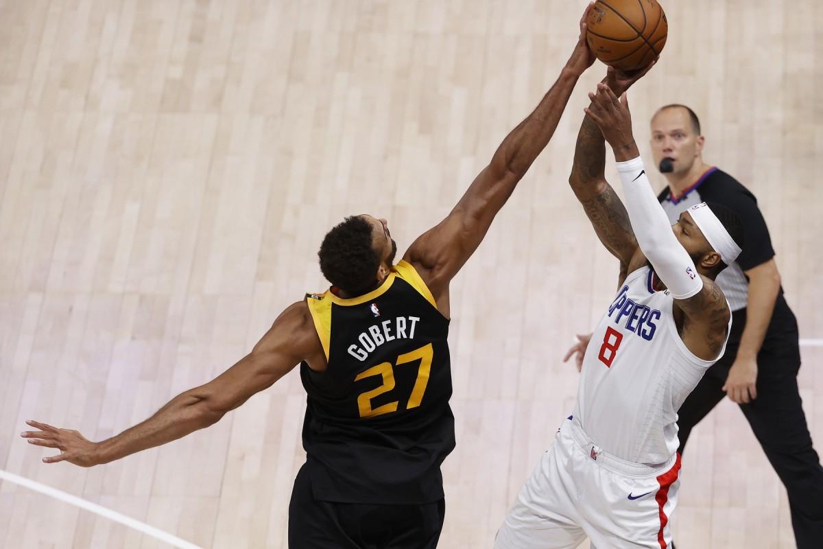 Rudy Gobert (27) blocks Marcus Morris (8) to seal the win for the Utah Jazz