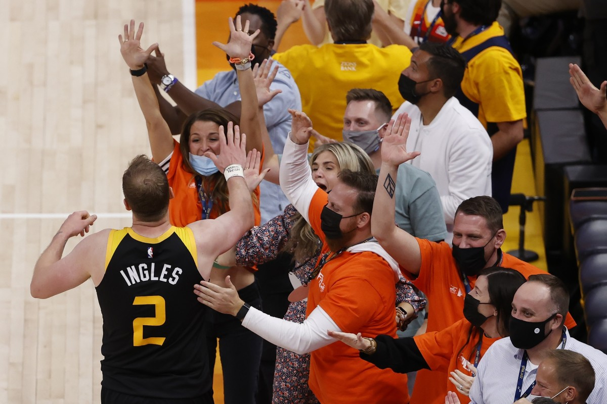 Joe Ingles (2) celebrates with fans during the Jazz 112-109 win over the Los Angeles Clippers