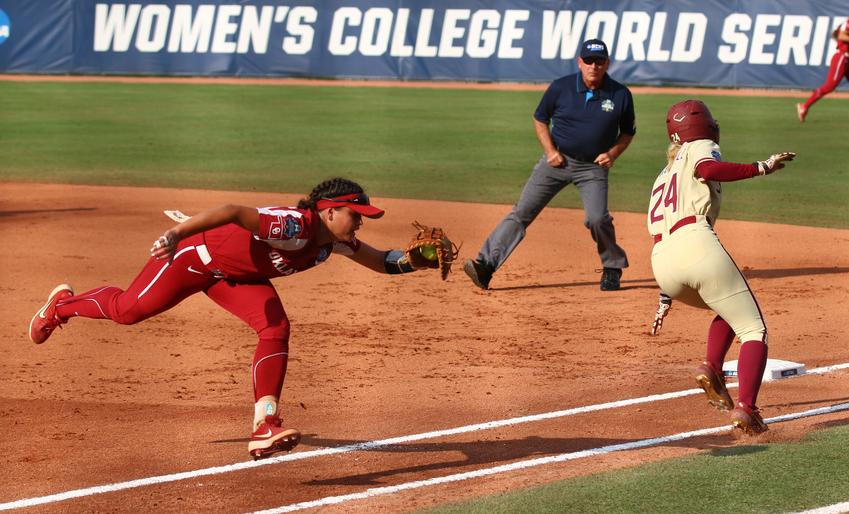 Sydney Sherrill avoids Taylon Snow's attempted tag in the bottom of the first inning
