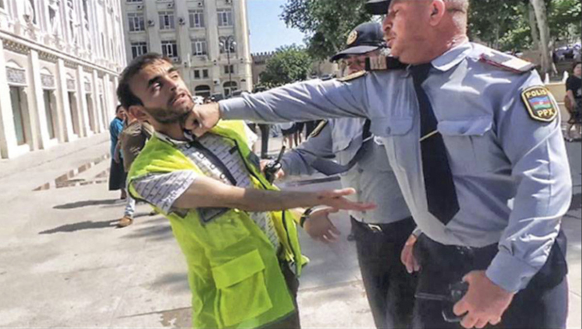 Aliyev went viral in 2013 after he was photographed being punched by a police officer at a protest.