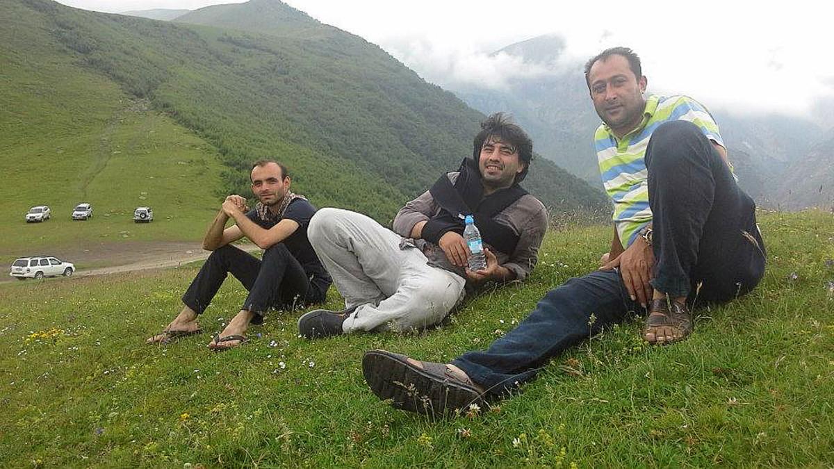 Aliyev (far left) with Emin Huseynov (center).