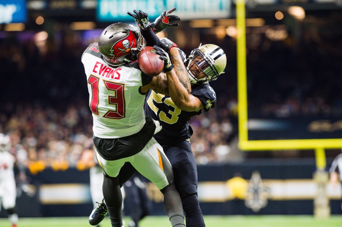 New Orleans Saints cornerback Marshon Lattimore breaks up a pass to Tampa Bay receiver Mike Evans. Mandatory Credit: Scott Clause/The Daily Advertiser via USA TODAY NETWORK
