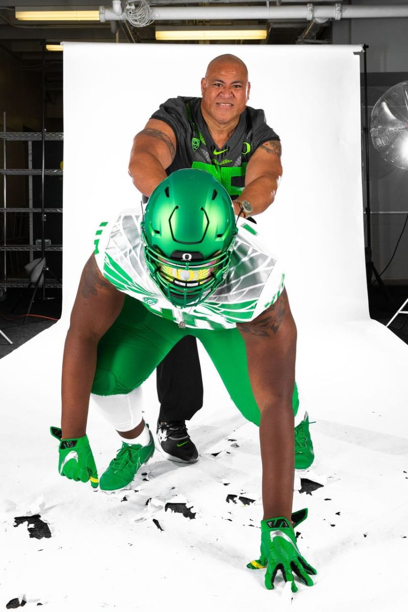 Sir Mells poses for a photo during his official visit to Oregon with Defensive Line Coach Joe Salave'a.